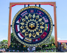 Buddhist Giant Gong With Asian Flags In Wat Tham Khuha Sawan Buddhist Temple In Thailand