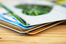 Many Bank's Card And Prepaid Payment Card On Wooden Background