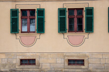 Two Red Wooden Windows In An Old Franconian Sandstone Building