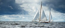 Old Expensive Vintage Wooden Sailboat (yawl) Close-up, Sailing In An Open Sea. Dramatic Cloudscape. Coast Of Maine, US