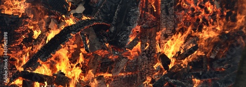 Fototapeta Ruins of the wooden country house and fence in a flame. Fire and smoke textures close-up. Forest fires in summer. Seasons, ecology, ecological issue, environmental damage, disaster, danger concepts obraz