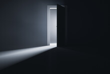 A Slightly Open Door To A Room With Bright Light.