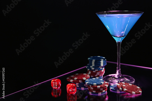 Casino chips, dice and cocktail on dark background, space for text - fototapety na wymiar
