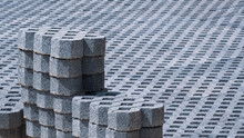 Focus At Stack Of Paving Turf Stone Blocks With Blurred Pavement Floor In Gardening Site Area