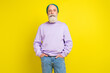 Photo portrait of aged man confident serious wearing trendy outfit headwear isolated bright yellow color background