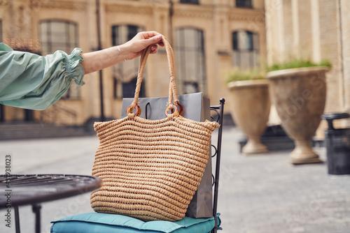 Obraz Close up shot of woman holding bag - fototapety do salonu