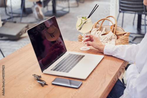 Obraz Close up of pritty business woman drinking cocktail - fototapety do salonu
