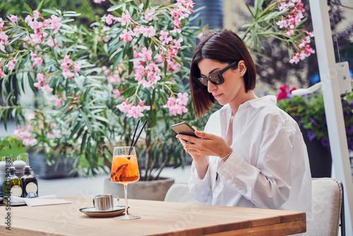 Obraz Attractive girl drinking aperol - fototapety do salonu