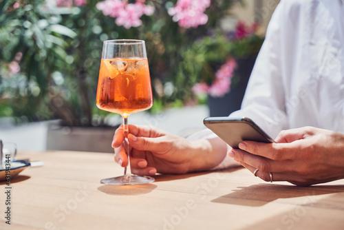 Obraz Close up shot of girl drinking aperol - fototapety do salonu