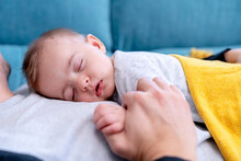 Cute Baby Boy Sleeping On Father At Home