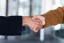 Business Partners Shaking Hands Outdoors