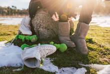 Legs Of Female Ice-skater Changing Footwear