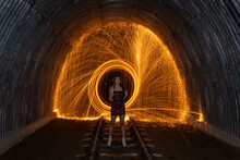 Woman Spinning Wire Wool In Tunnel