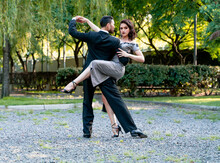 Male And Female Tango Dancers Doing Rehearsal In Public Park