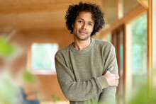 Curly Hair Man Staring While Standing At Spacious Room