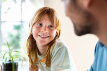 Cute Redhead Girl Smiling At Her Father