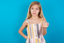 Beautiful Caucasian Little Girl Wearing Stripped Dress Over Blue Background, Inviting You To Come, Confident And Smiling Making A Gesture With Hand, Being Positive And Friendly.