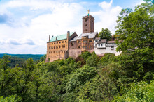 Wartburg Castle By Thuringer Forest Against Cloudy Sky At Eisenach, Germany