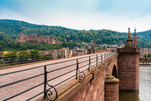 Brueckentor Gate At The Alte Bruecke, Old City, With The Palace And Castle Of Heidelberg, Germany