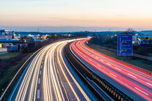 Germany, Baden-Wurttemberg, Vehicle Light Trails On A81 At Dusk