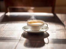 Cup Of Hot Green Tea On Wooden Surface