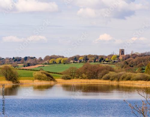 Fototapeta Early springtime sunshine on Pickmere Lake, Pickmere, Knutsford, Cheshire, UK