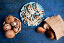 Brown Edible Mushrooms Lying On Blue Wooden Surface