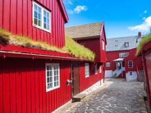 Road Amidst Red Houses In City, Torshavn, Faroe Islands, Iceland