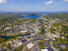 Laconia City Center And Opechee Bay Of Lake Winnipesaukee Aerial View With Fall Foliage In Downtown Laconia, New Hampshire NH, USA.
