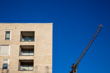 Germany, Bavaria, Munich, New Building On Construction Site With Crane