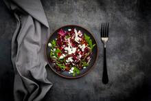 Studio Shot Of Plate Of Vegetarian Salad With Lentils, Arugula, Feta Cheese, Radicchio And Bell Pepper