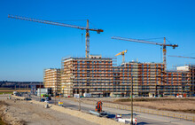 Germany, Bavaria, Munich, Large Construction Site With Cranes