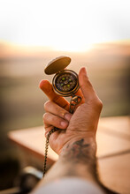 Young Man's Hand Holding Navigational Compass