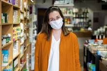 Young Woman Wearing Protective Face Mask Standing In Grocery Store