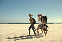 Male And Female Tourist Walking On Sand Against Sky During Sunny Day At Weekend