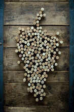 Wine Bottle Cork In The Form Of Vine On Rustic Wooden Background