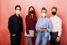 Confident Business People Wearing Protective Face Mask Standing Against Colored Background