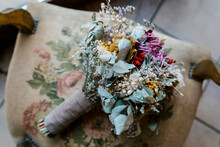 Wedding Bouquet On Chair At Banquet