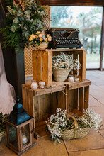 Wooden Rack Decorated With White Flowers At Banquet
