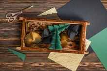 Three Dimensional Render Of Wooden Box With Simple Paper Crafts