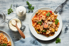 Two Plates Of Bow Tie Pasta With Vegetables And Vegan Parmesan