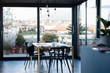 Dining Table By Transparent Windows At Home