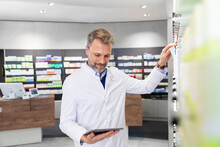 Male Pharmacist Doing Inventory With Digital Tablet