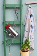 Green Ladder, Pair Of Old Scissors, Sieve, Potato Masher, Two Jugs, Planted Daffodil Bulbs And Coathanger With Dish Towel Covered In Various Prints