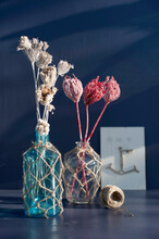 Dried Flowers In Vases Decorated With Macrame
