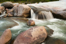 Water Rushes Over Granite Boulders During The Dry Season Along The Cangrejal River, Honduras.