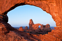 Sunrise Lighting Window And Turret Arch In Arches National Park.