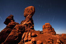 Balanced Rock And Star Trails During A Near Full Moon At Arches National Park.