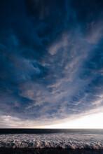 A Cumulonimbus Mammatus Storm Cloud Crawling Pushing Away The Sunny Evening In What Will Soon Be A Giant Thunder Storm In La Libertad, El Salvador.