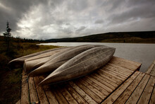 Canoes Rest On The Dock Of Wonder Lake As A Morning Storm Approaches.